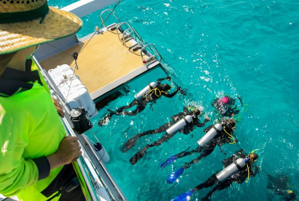 Scuba Divers on Great Barrier Reef Tour Cairns onboard Passions of Paradise Catamaran
