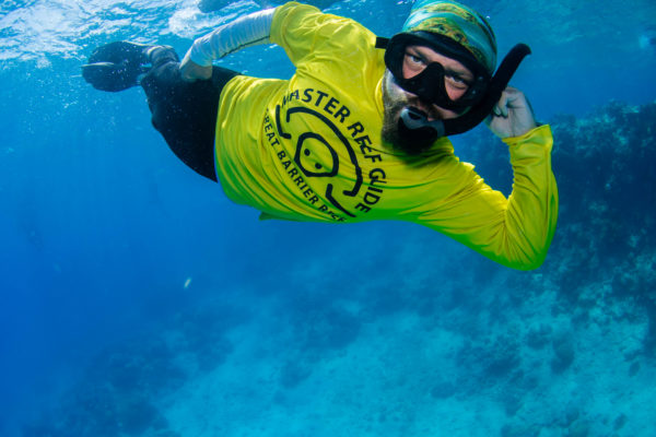 Russell Hosp Master Reef Guide being silly while on great barrier reef cairns for Coral Nuture Program
